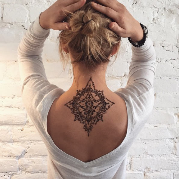 lower neck henna design tattoo