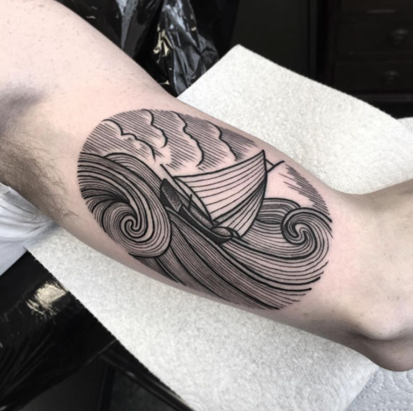 black boat and sea tattoo