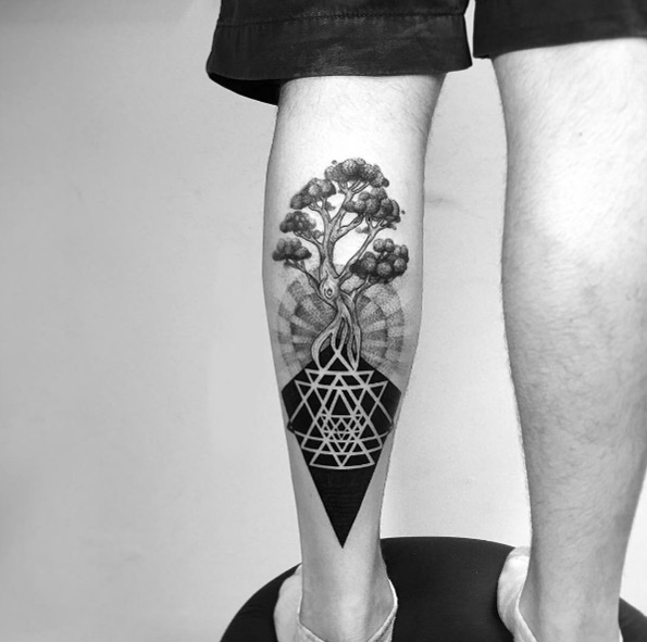 Geometrical tree balck tattoo on carve