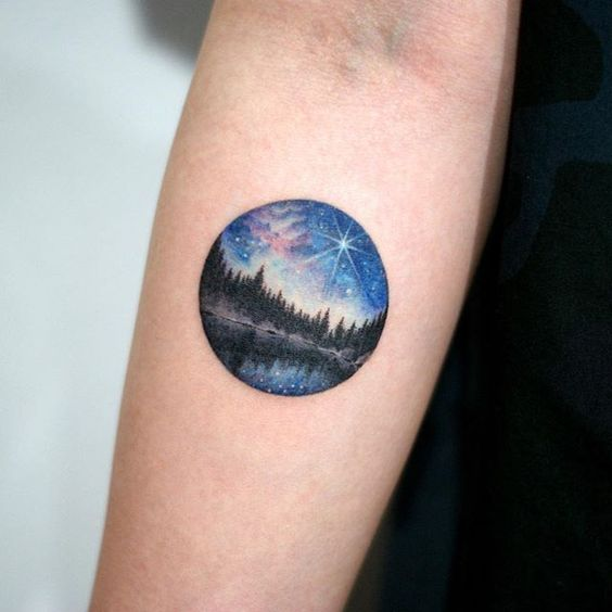 Landscape forearm tattoo - night sky and mountain