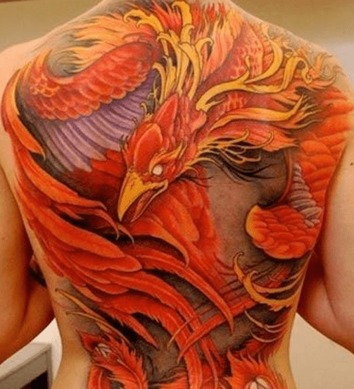 Phoenix rising from ashes full back tattoo